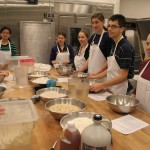Students make bread with Lead Baker Michael Menard.