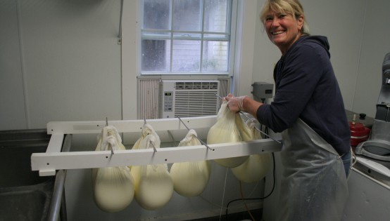 Stina Kutzer, owner of Gammelgården Creamery in Pownal, VT, hangs bags of Skyr to drain. Her Skyr is available at the EcoCafé in Morley Science Center.