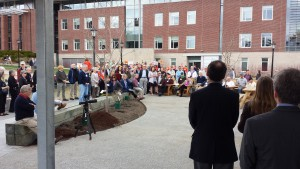 A crowd gathers for the building's dedication. (Photo taken from under the building's pergola.)
