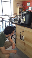 Julio does research on the Keurig Machine to analyze its energy efficiency.