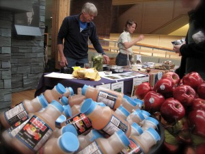Local apple cider and apples with Bill Stinson from Peace Valley Farm in the background.  Photo credit - Celeste Berg