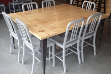 This table is made from interior walls of the old Kellogg House. The chairs are made from plastic bottles.