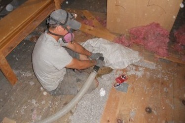 Spaces beneath floorboards in the Oakley Center's attic were packed with cellulose.