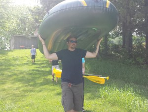 justin carrying raft