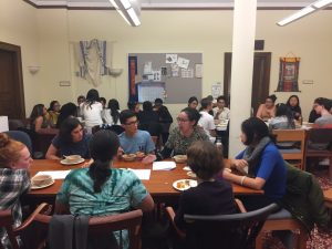 Students discuss religion and colonialism at the Interfaith/VISTA dinner.