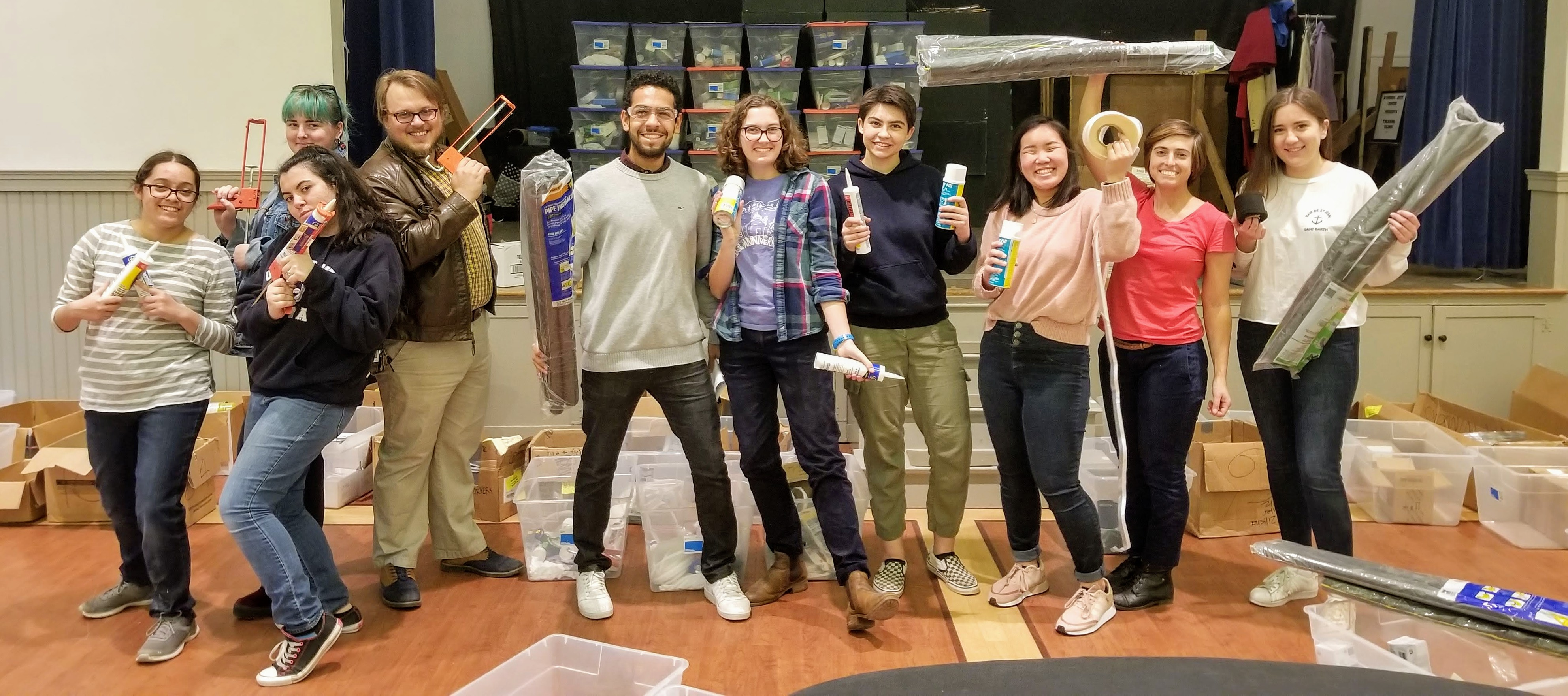 Students posing for a photo as part of the Winter Blitz home weatherization day.