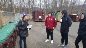 Sustainability Tour of Campus - Korinna Garfield '19 - at the compost storage area